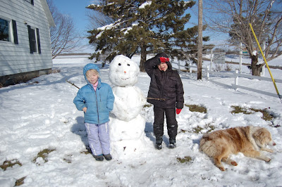 farm kids with April snowman