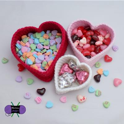 http://www.ravelry.com/patterns/library/heart-nesting-baskets