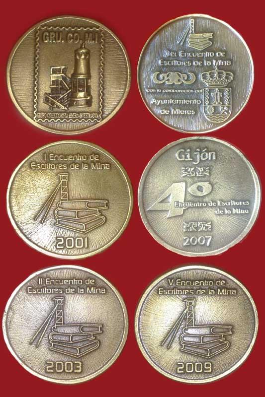 Medallas de los cinco Encuentros de Escritores de la Mina de GRUCOMI