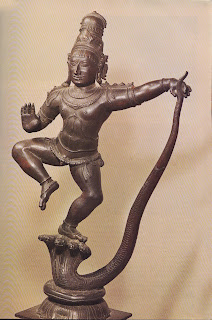 Krishna subduing the serpent demon Kaliya, which inhabited the River Jumna and had been terrorising the people living along its banks. Though only a boy, Krishna overcame Kaliya by dancing on his heads. Chola bronze, sixteenth century. Victoria and Albert Museum, London.