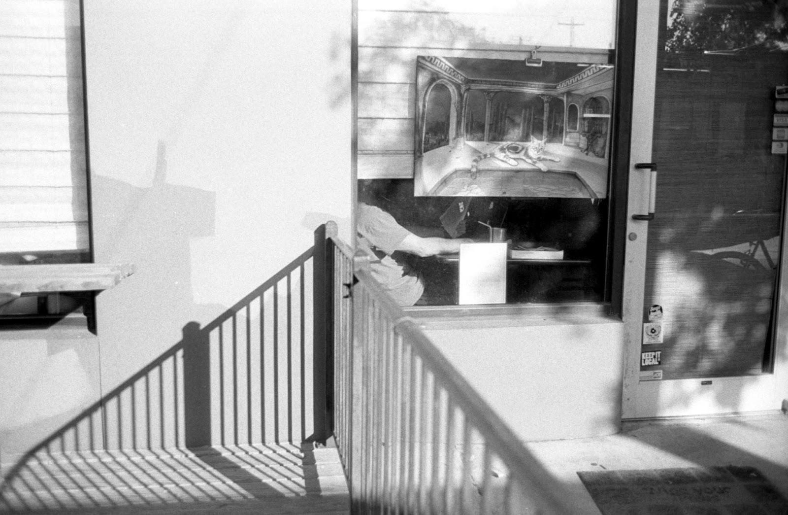 Shadows outside La Tazza Fresca on Guadalupe Street