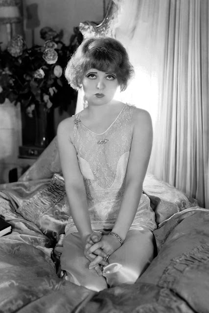 clara bow wearing lace and satin
