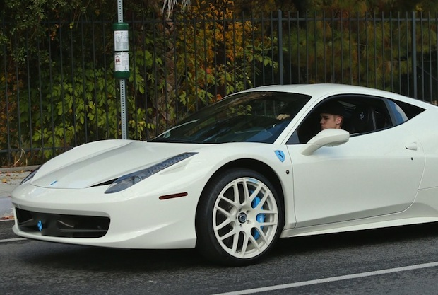 458 is  the custom Ferrari badges and brake callipers that are paintedWhite Ferrari 458 Italia Justin Bieber