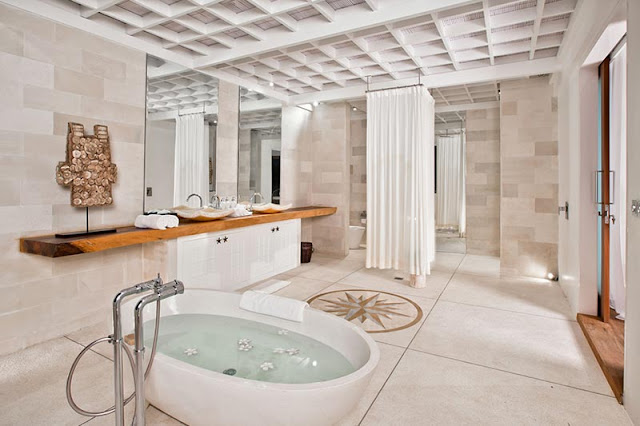 Picture of modern tropical bathroom with white marble
