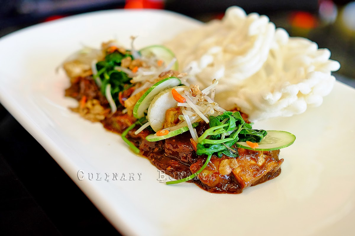 Rujak Cingur, a traditional delicacy from Surabaya, fresh salad with sweet shrimp paste sauce called petis, and topped with sliced beef nose