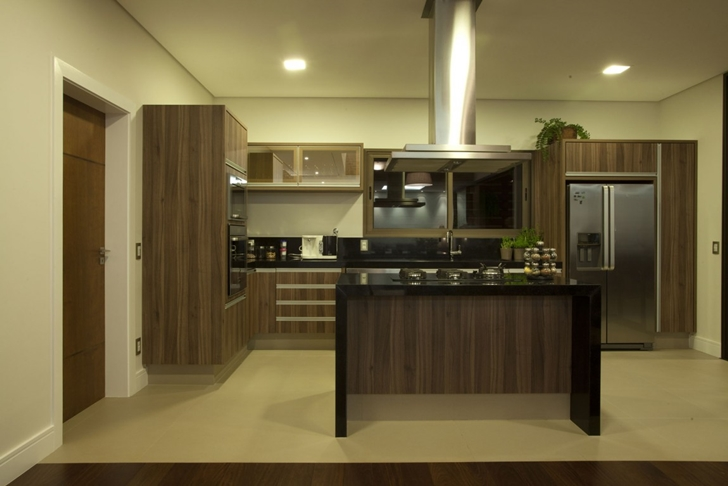 Kitchen at night in Elegant dream home in Sao Paulo by Pupo Gaspar Arquitetura
