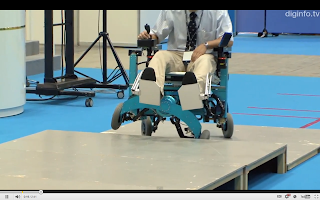 robot wheelchair climbing up a step