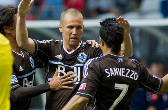 Vancouver Whitecaps player Kenny Miller celebrates after scoring against New England Revolution