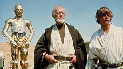 Alec Guiness as Obi Wan Kenobi and Mark Hamill as Luke Skywalker Star Wars movieloversreviews.blogspot.com