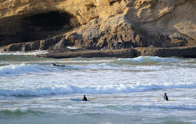 Photo of surfers at Pacific City Oregon by Nancy Zavada