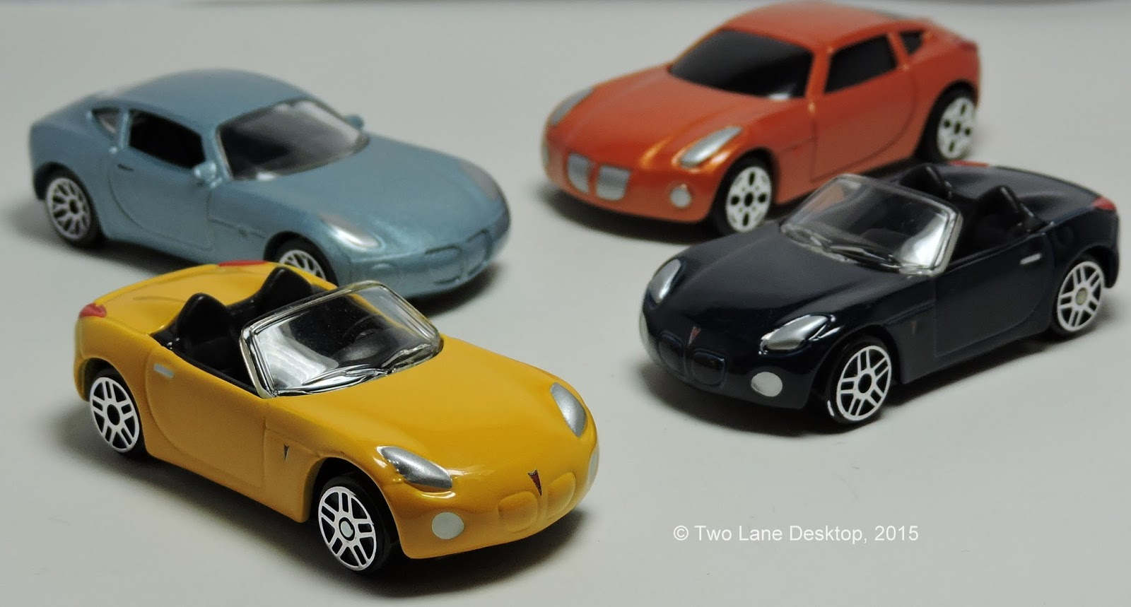 Two Lane Desktop Maisto and Matchbox Pontiac Solstice coupe and