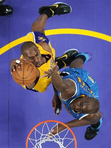 kobe bryant dunking on someone. kobe bryant dunking on someone