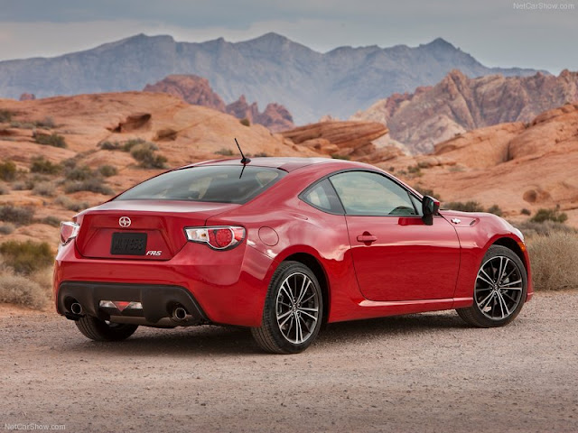 Rear three-quarters view of red 2013 Scion FR-S in desert setting