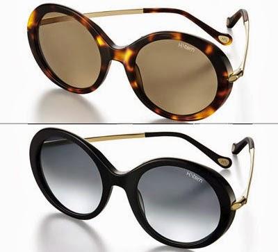 óculos de sol H. Stern modelo arredondado marrom e preto com detalhes dourado nas hastes