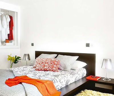 dormitorio pequeño blanco y naranja