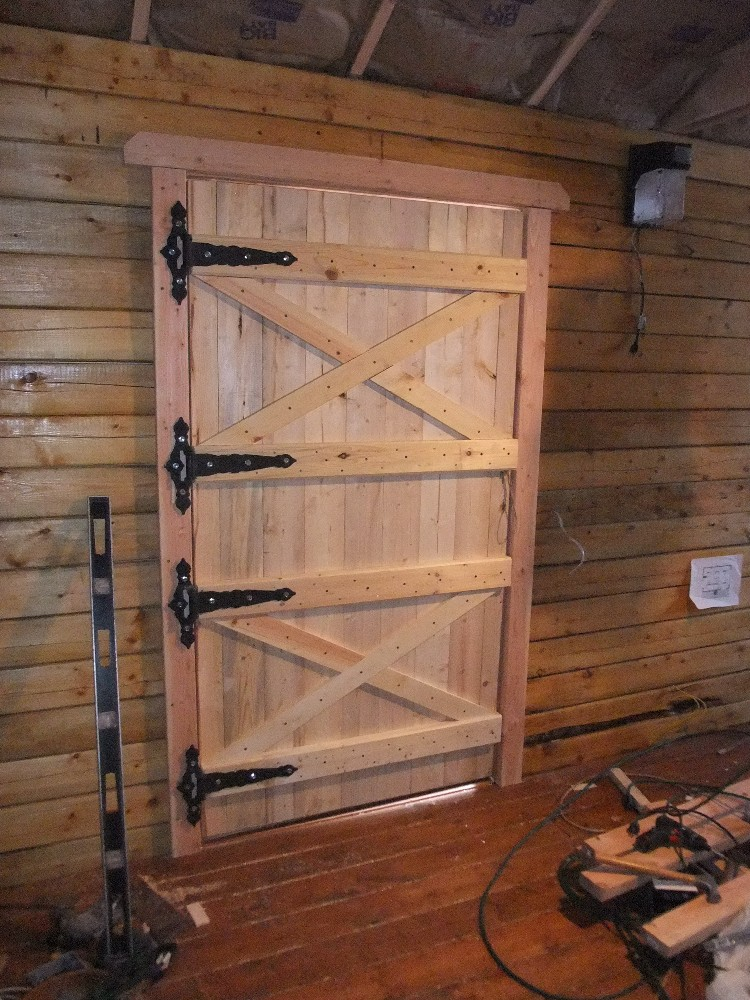 the adventures of us log cabin wood shop snow door and stove