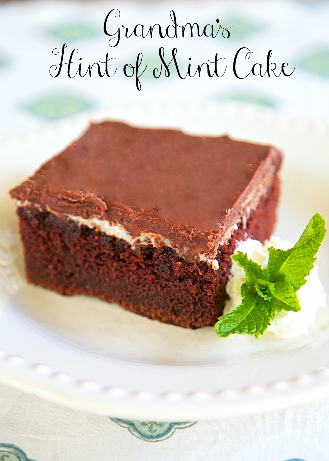 Grandma's Hint of Mint Cake Recipe - quick homemade chocolate cake, topped with Peppermint Patties and a homemade chocolate frosting. Great for a potluck dinner - super easy to transport. We like it with a scoop of vanilla ice cream!