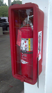 fire extinguisher encased in glass