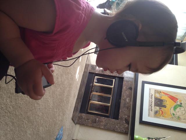 Baby Bear listening to music on headphones