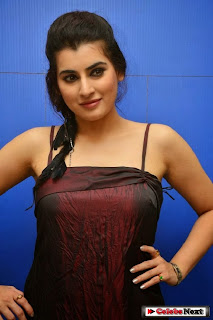 Archana veda in Lovely Sleevelss Dark Maroon Gown