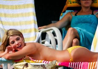 Ashley Greene wears a Yellow Bikini at New York