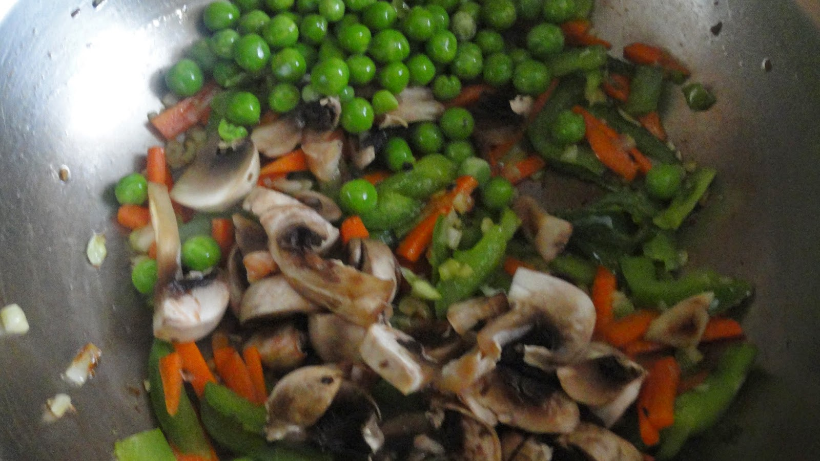 add mushrooms and peas for vegetable fried rice