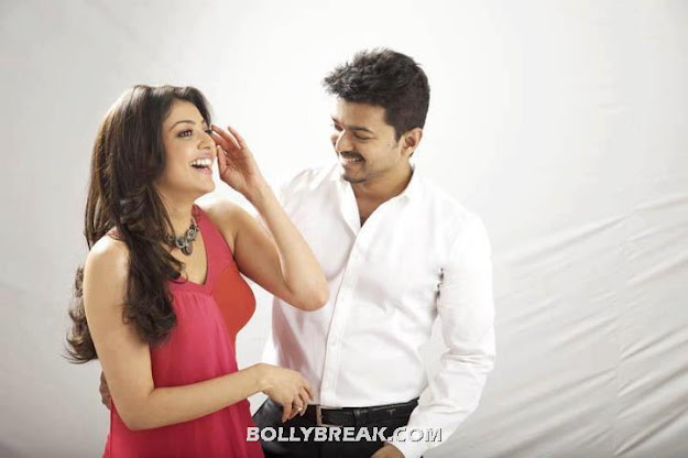 Kajal agarwal laughing in red dress - Kajal agarwal Thupakki movie photoshoot - red dress