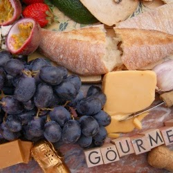 Fresh crusty breads, gourmet cheese and fruit for a fruit basket