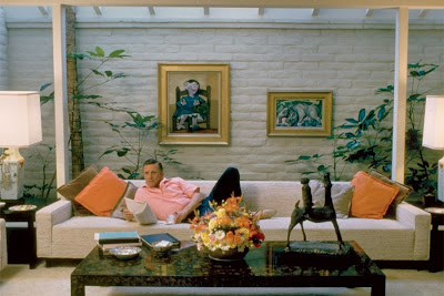 Kirk Douglas stretches out on a skylit sofa in his Beverly Hills home in the early 1960s