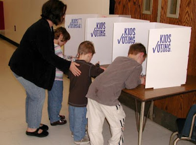 Kids at a voting booth