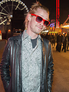 Macaulay Culkin reportedly threw himself at a photographer on Tuesday