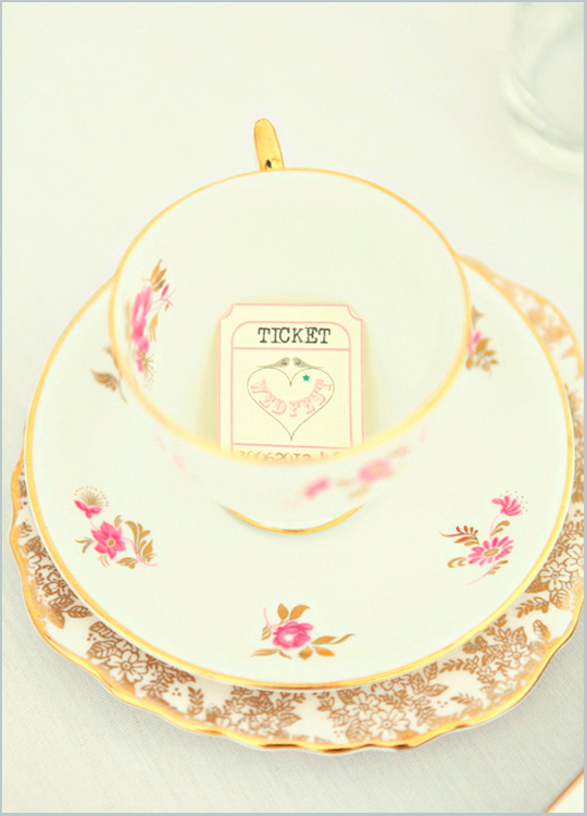 pink and gold vintage teacup on gold plate