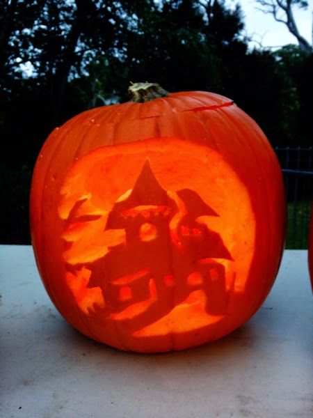 Pumpkin carved with spooky house