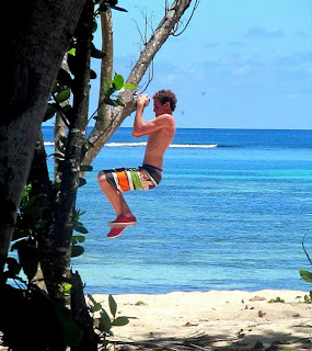 fun ways to exercise at the beach - tree pull ups