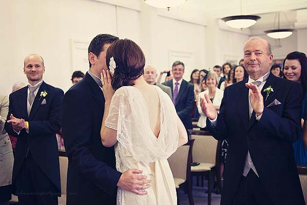 bride and groom kissing at Marylebone Town Hall wedding