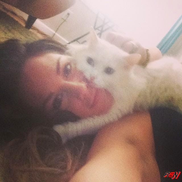 Former WWE Diva Kailtyn Playing With Her Pet.
