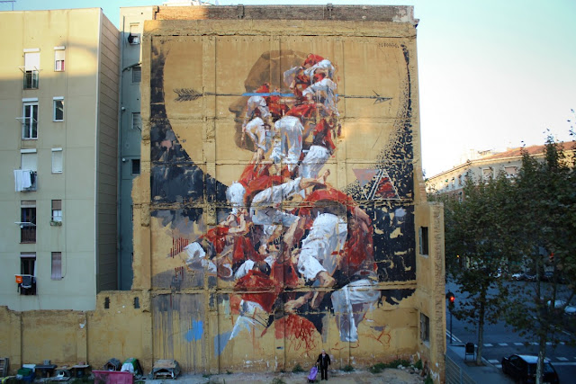 Borondo recently spent some time in Barcelona, Spain where he was invited by the good lads from Open Walls Conference to create a new piece.