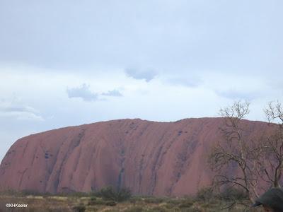 Uluru under a cloudy sky