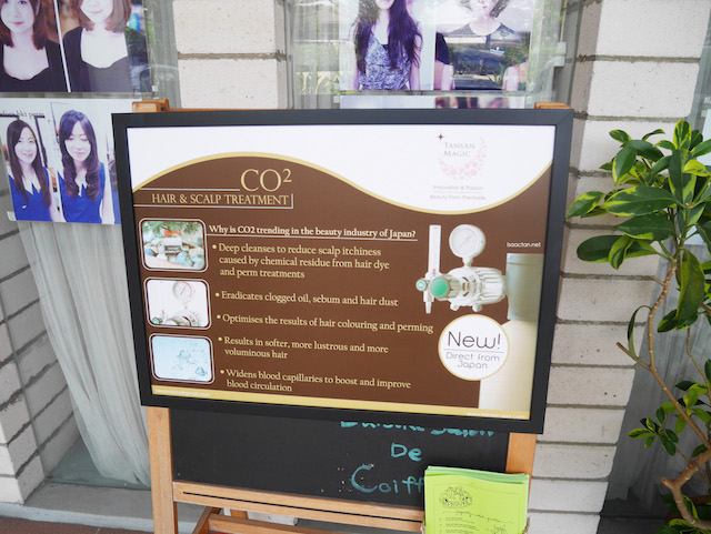 A notice promoting their CO2 Hair & Scalp treatment