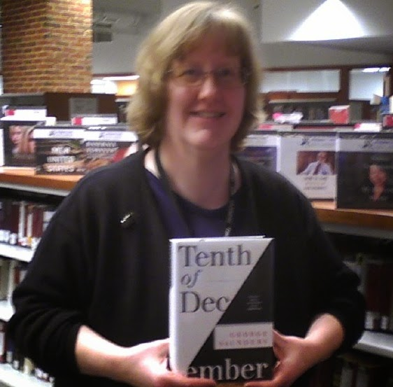 Valarie of Olney Library with book Tenth of December by George Saunders