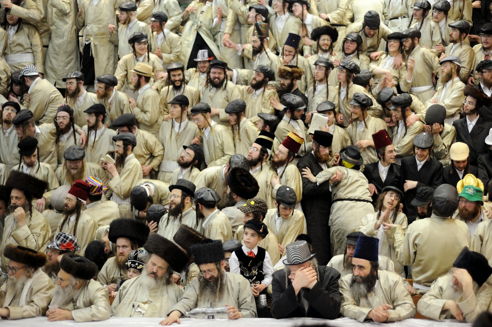 Copyright: ©Gili Yaari, Israel, Shortlist, Arts & Culture, Professional, 2015 Sony World Photography Awards. Image name: Purim Holiday in Jerusalem. Description: Ultra-Orthodox Jewish men of the Toldot Aharon Sect celebrate the Purim holiday in the ultra-orthodox Mea Shearim neighborhood in Jerusalem on March 17, 2014. The festival of Purim commemorates the rescue of Jews from a genocide in ancient Persia.