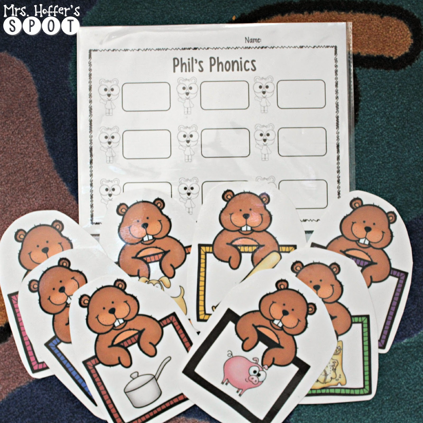 "This is ""Phil's Phonics"" the students look at the picture, use the logs, and spell the cvc words on their response sheet."