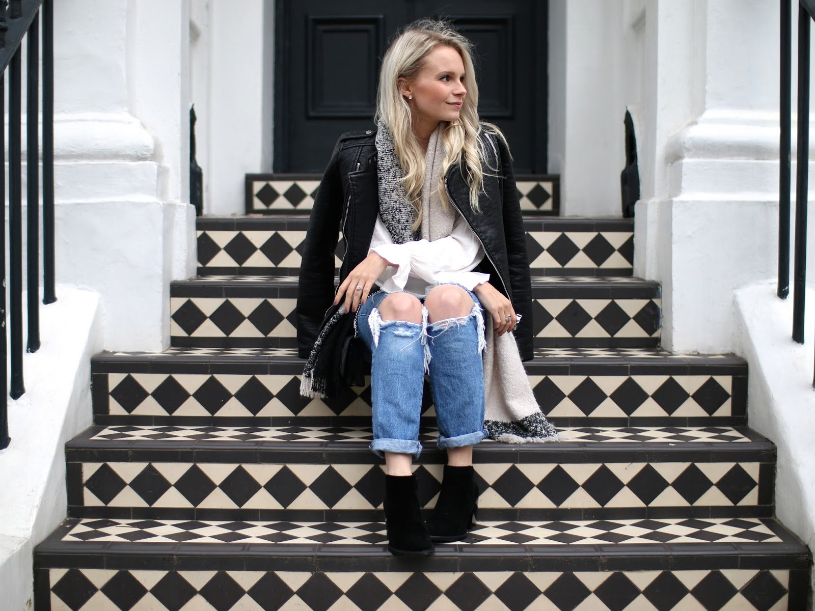 pretty london tiles in notting hill, all black and white floors, fashion blogger in ripped jeans