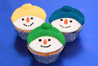 3 cupcakes topped with fondant snowmen heads