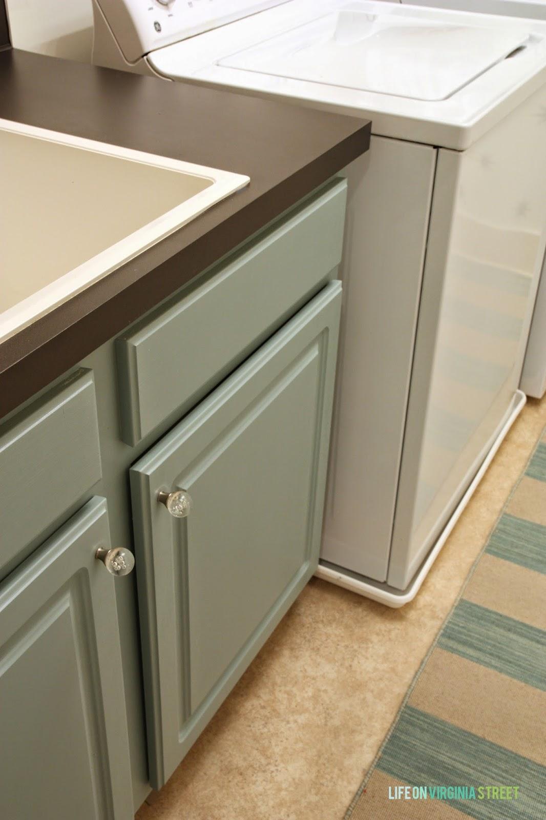 Aqua laundry room cabinets