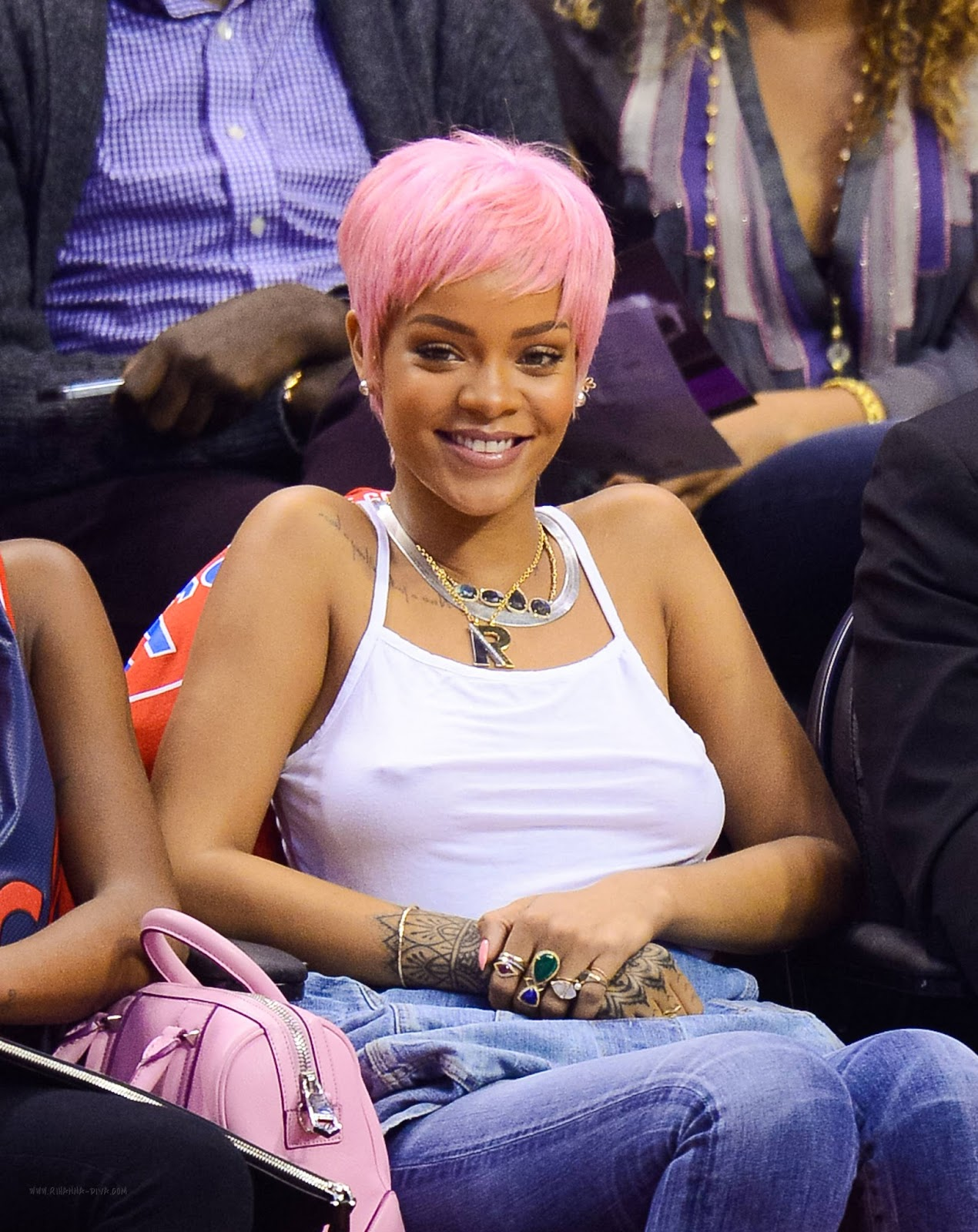 Rihanna Press Her Boobs at Clippers Game in Los Angeles