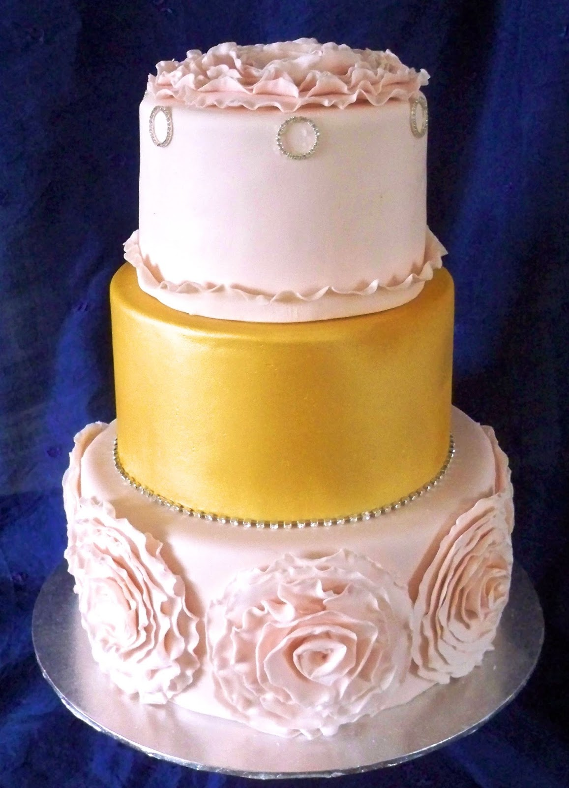 Cute and elegant pink and gold frill wedding cake