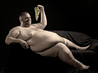fat man in sofa with black blackground