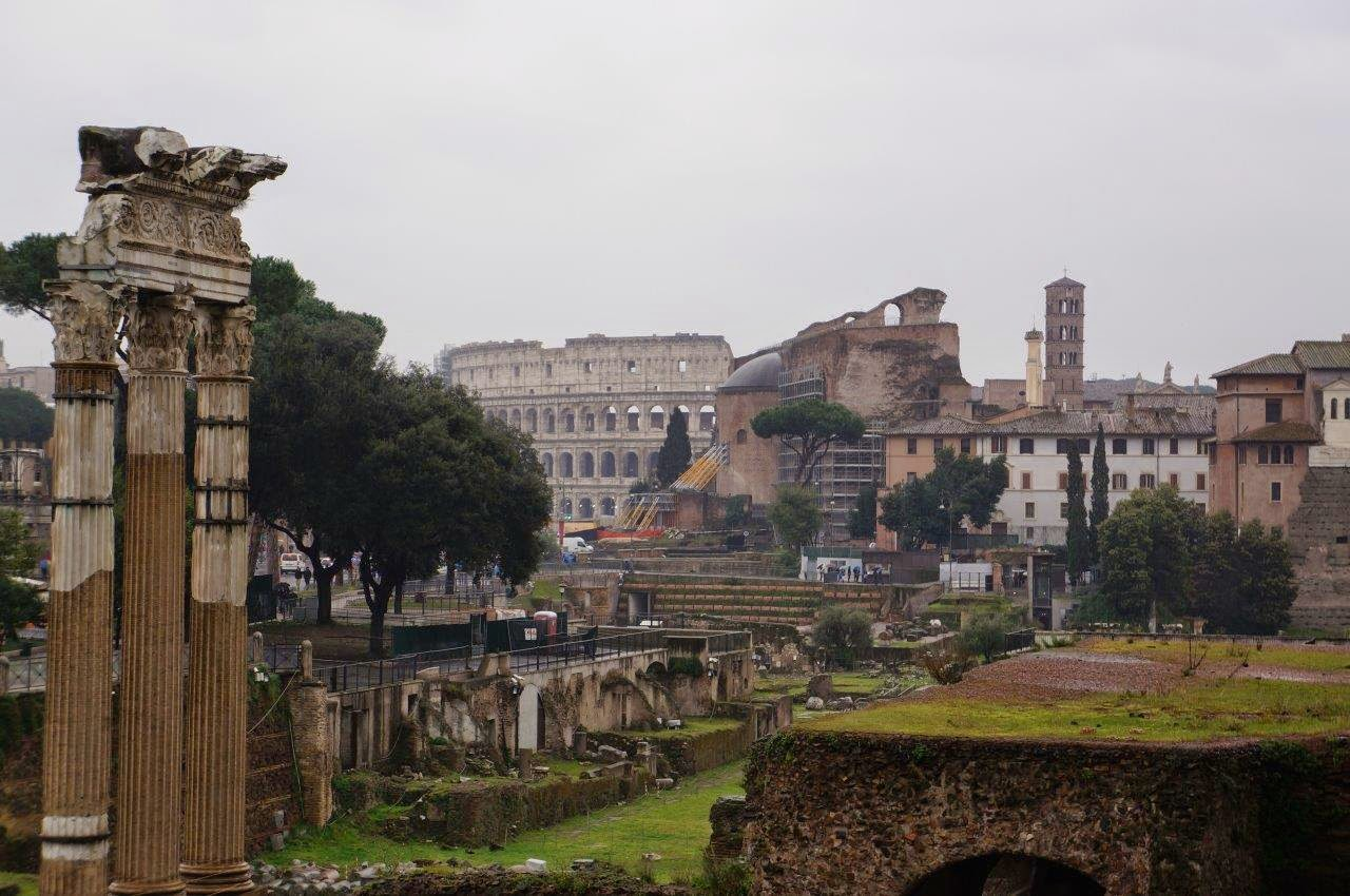 Roman Forum with Colosseum in background, Rome Italy.