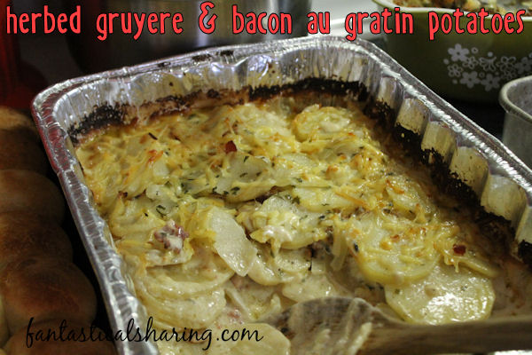 Herbed Gruyere & Bacon Au Gratin Potatoes | Au gratin potatoes get a fancy twist with a spiced herb cream and gruyere cheese with everyone's favorite: bacon! #bacon #Thanksgiving #recipe